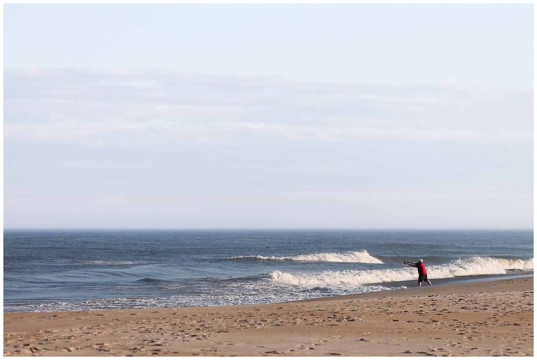 Fisherman casting a line in the Outer Banks of NC | Nicole Watford Photography